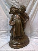 niños en bronce
