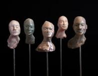 cabezas decoración en bronce