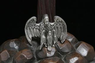 pelíkano y monte en plata y bronce
