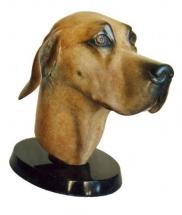 cabeza de perro en bronce