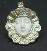 Medalla de ORO y MARFIL tallado
